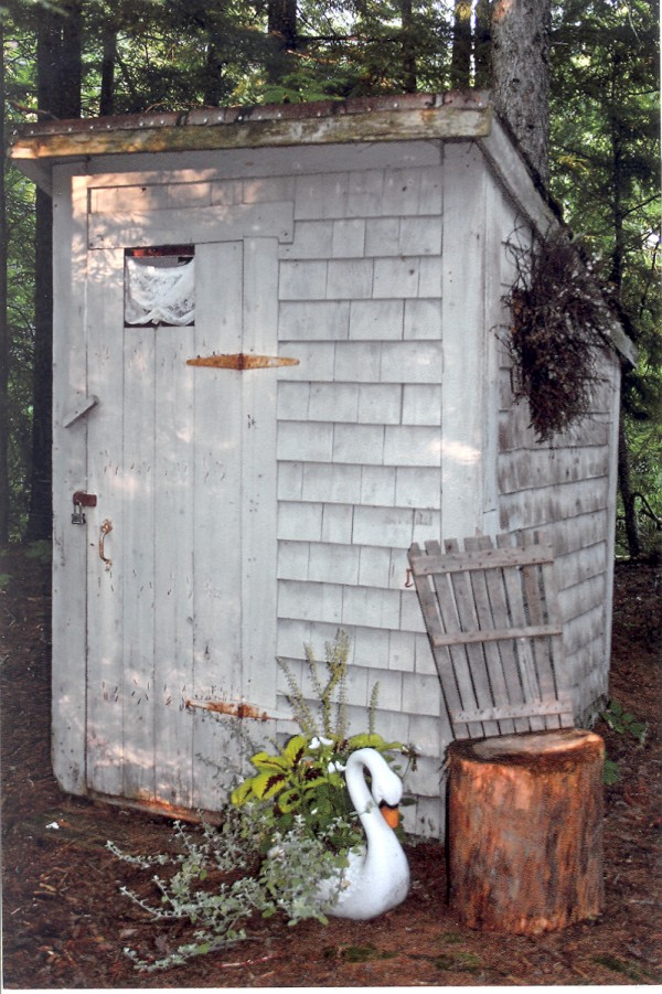 """Growing up in the 1940s, outdoor toilets weren't uncommon. I remember going there after meals to avoid washing dishes. A Sears Roebuck Catalogue was a staple, not for reading as you might think, but toilet paper. No wonder old timers spoke of having """"pyles!"""" I inherited a log cabin built on Lake Sysladobsis in the 1930s. No indoor plumbing facilities … behold the backhouse. The younger generation was appalled, turned up their noses. We developed our original shabby-chic look in our ancestor's original outhouse to make it more appealing. Primitive toille was painted on walls. Matching cushions placed on the stool provide comfort for mothers waiting for small children. No Sears Roebuck Catalogue, we have a 1913 edition of Abercrombie and Fitch. It better not be used for toilet paper! My aunt's original bowl and pitcher sit in the corner for hand washing. If you're in a hurry, it's okay to use the handiwipes. Plenty of old nails provide a place to hang towels. Flowers add good smells, make you feel like you're in Shoji Tabuchis' bathroom in Branson. Lace curtains, ornately framed grandchildren's artwork, an old mirror, and a rug on the floor complete our look. Early fixtures remain. Our ancestors smartly knew a cabinet on the wall kept toilet paper safe from mice. Not sure if a punched tin can holding moth balls kept critters or the stench away. Either way, it's worth a try. Outside sits a tree stump wiht an old canoe seat back. Sometimes you have to wait your turn -- it's a one-holer. A removable shutter is on the front door with painted instructions to hang below off season. A twig wreath completes the shabby-chic look. Our grandchildren would sure appreciate sweet smells from some of your potpourri."""