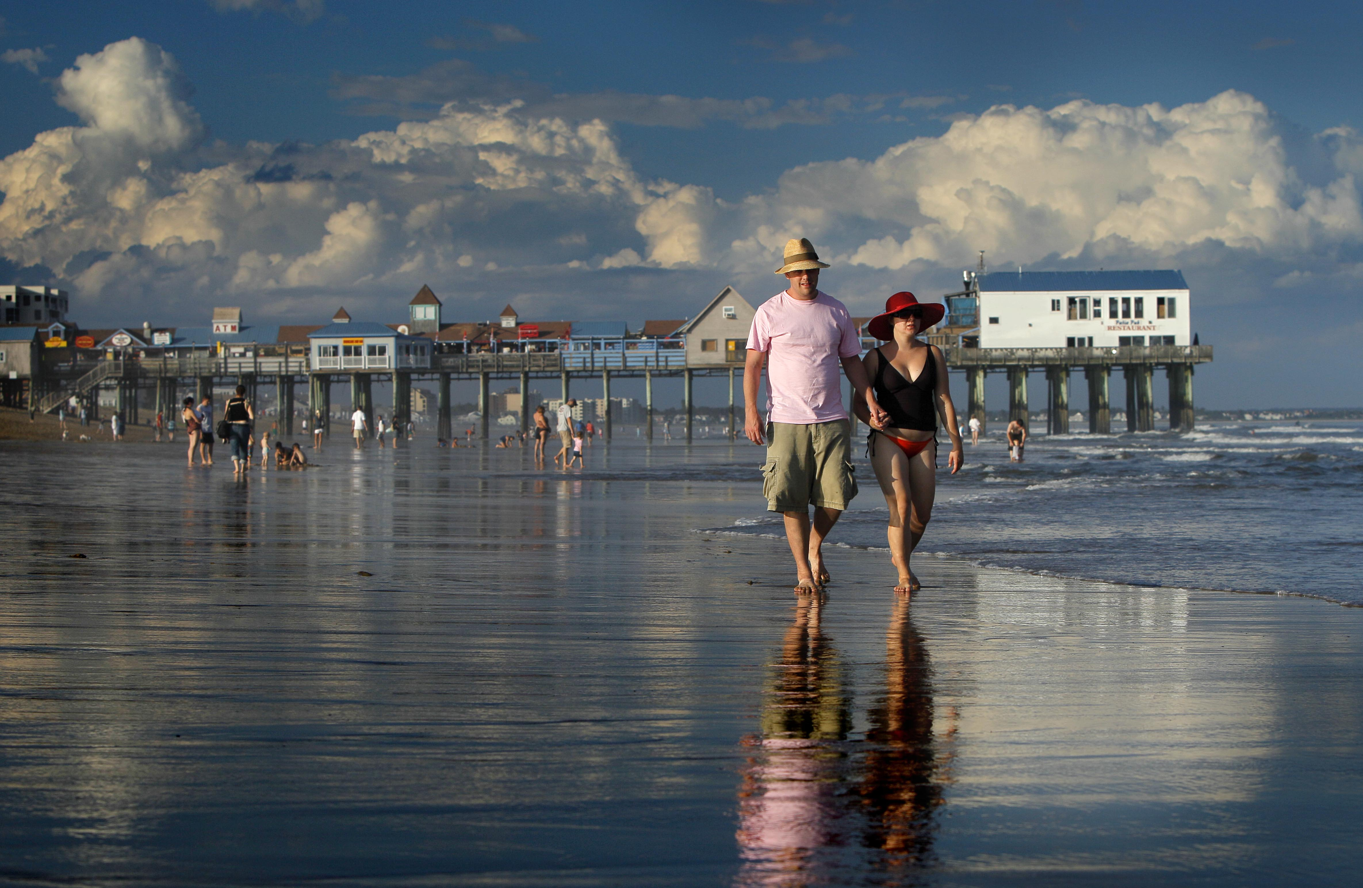Dan Horner (left) and Cynthia Belaskie of Toronto stroll along the ocean in Old Orchard Beach in August 2010. Tourism is Maine's most important industry, generating more than $531 million in tax revenues and supporting 176,633 jobs in 2006, according to the Maine State Planning Office. Tourism officials are already optimistic about this summer.