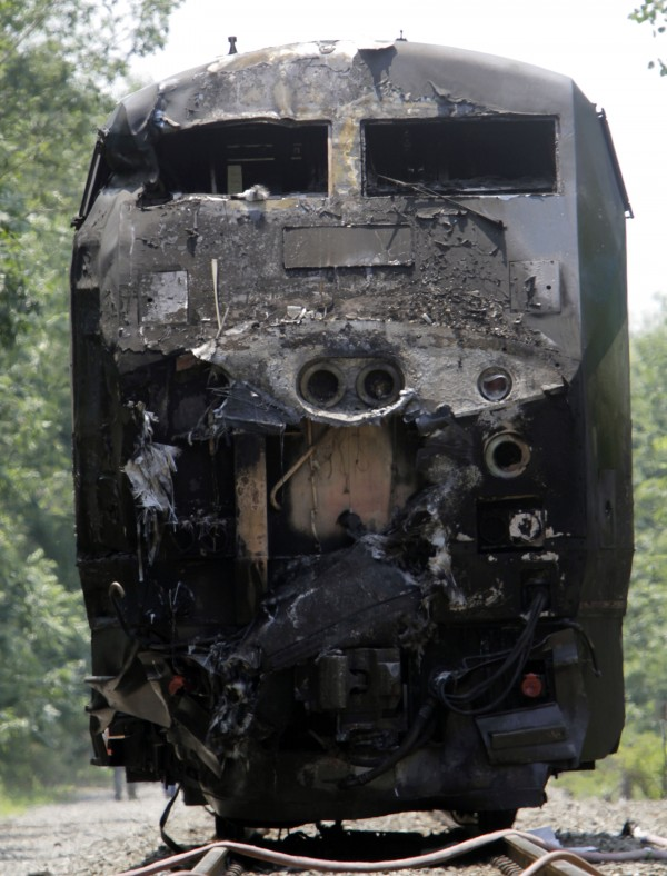 The charred engine of the Amtrak train that collided into a tractor-trailer is seen Monday, July 11, 2011 in North Berwick, Maine.