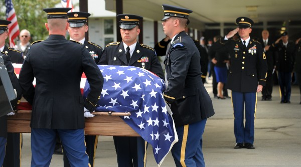 Army Staff Sgt. Robert Springmann (right) salutes as his son Pfc. Tyler Springmann's casket is placed into the hearse after a memorial service at  Nokomis Regional High School in Newport on Friday, July 29, 2011. Tyler Springmann, 19, of Hartland was killed in Afghanistan on July 17, 2011.