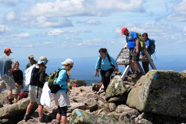 A few of the hikers who reached the summit gather around the summit sign on Katahdin on a perfect summit day last Tuesday.