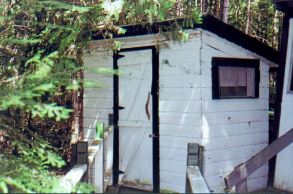 We purchased our camp with outhouse some thirty years ago on the Upper Narrows of Cold Stream Pond. One of the first projects was to panel with pine the entire inside of the outhouse. Afterwards I built a fine vanity table and chair for those that may want to freshen up on the way out. Additionally, there is ample reading material provided for those that might like to linger a while. There are two windows, one on the North side and one on the South which allow excellent cross-ventilation and which I think it necessary in an outhouse, don't you? Our outhouse has provided our family with excellent service over those thirty years except for one day on a cold February afternoon. We were having a family day of ice fishing at camp when my brother Brent had a sudden attack of the runs. He ran for the outhouse and, in anticipation of relief on the throne, he dropped his pants as he reached for the door but alas, the door was frozen shut! The ice fishing wasn't all that great either!
