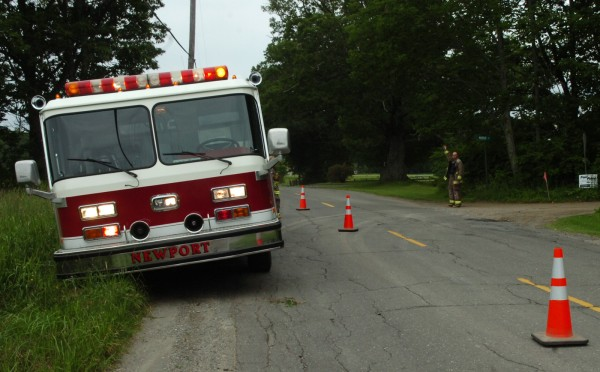 Newport emergency crews direct traffic on Stetson Road in Newport, near the scene of an ATV rollover accident which occurred on nearby Murray Road Sunday, July 3, 2011.