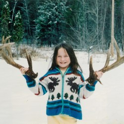 Ann Pollard, then 9, holds up the next to last set of antlers from His Majesty in the spring of 2003.