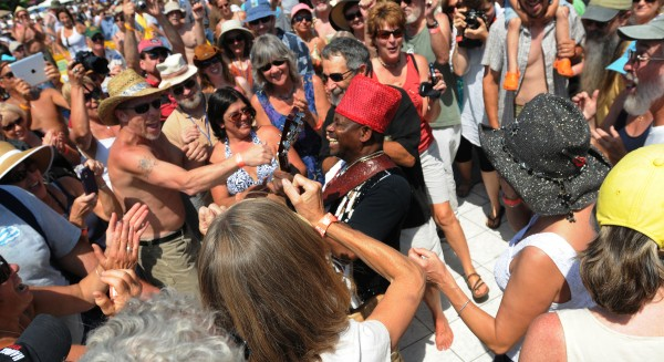 Lil' Ed Williams is surrounded by dancers as he strolls onto the dance floor at the 18th annual North Atlantic Blues Festival in Rockland on Saturday, July 16, 2011.