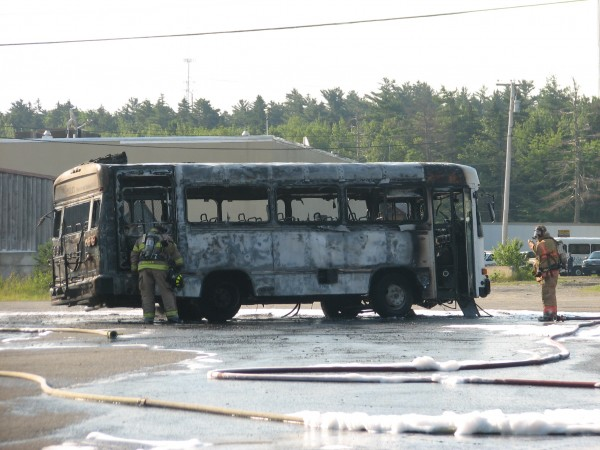 Ellsworth firefighters inspect a charred Island Explorer bus Wednesday morning behind the Maine Coast Mall to make sure flames have been extinguished. Fire officials are unsure how the fire started but no one was injured in the blaze, which started as passengers sat waiting on the parked vehicle. An alert passenger smelled smoke and got other passengers off the bus before it became engulfed in flames.