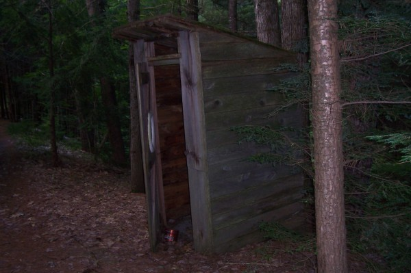 This outhouse has been in used for over 30 years, said  Sebastian Francis of Indian Island. It is now semi-retired but once in awhile someone brave enough goes to used it, even with the 3 spiders hanging out by the door.