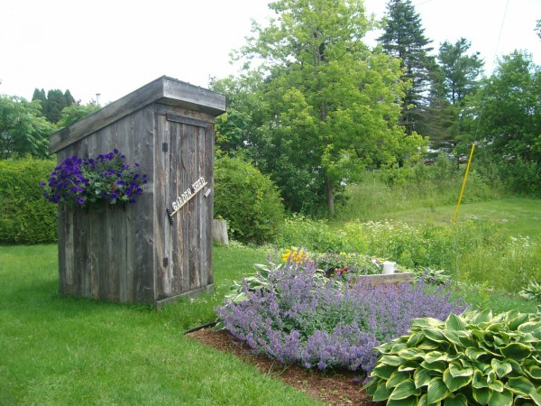 Cheryl Boulier of Presque Isle says her outhouse is made of barn board, large enough for two and is complete with a decorative flower box on the side and makes its home in my flower garden. Truly a topic of conversation for those walking past our home.