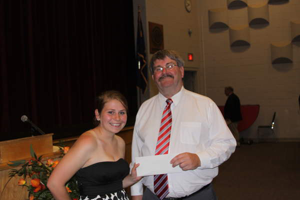 Ciera Bedard of Owls Head accepts the 2011 Maine Lobster Festival Scholarship from Hal Perry, vice president of grounds for the festival. The $2,000 scholarship is given each year in memory of Ken Black. Bedard, an honor graduate of Rockland District High School, plans to attend the University of New England in Biddeford.