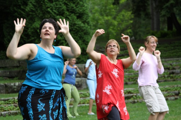 """Jen Kirchoff (from left) of Hope, Dagney Ernest of Thomaston and Melanie Dilorenzo of Hope celebrated National Dance Day on Saturday with a routine to a song from """"Grease."""""""