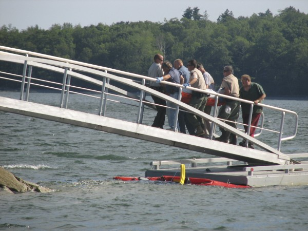 Police, paramedics and firefighters carry the body of a New Hampshire man up a ramp at Lamoine State Park on Sunday afternoon, July 10, 2011, after it was recovered from Eastern Bay, between Lamoine and Mount Desert Island.