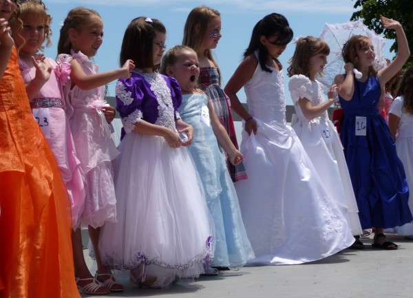 Not all of the lovely ladies dressed for the Miss Eastport contest Sunday were excited about the event Saturday afternoon. Dozens of girls in various age groups from toddlers to teens competed during Eastport's weekend Fourth of July festival. Other events included a cod fish relay race, a puppet show at the Eastport Arts Center, a torchlight parade in the evening, and dozens of vendors. &quotThis is what the Fourth of July is supposed to be all about,&quot Wanda Relando, 68, from Toledo, Ohio, said as she walked along Water Street. &quotThis is like I remember as a child. The people, the flags, the fun.&quot