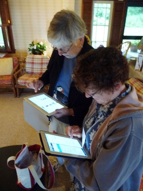 A recent Elderhostel/Roads Scholars retreat Down East blended yesterday's generation with new technology. Participants Kathy Potier, 75, of Lancaster, Pennsylvania (rear) and Cindy Piennett, 53, of Washington state, check their iPads during the final session of a week long stay at the park. &quotI can't live without it,&quot Piennett said. &quotEspecially when I travel. I use it to get motel rooms, check ferry schedules, find the history of an area.&quot Potier added &quotI confess I do get kind of obsessed.&quot