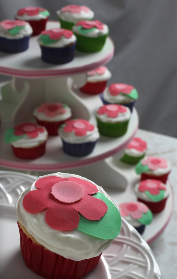 Custom decorations transform plain cakes into festive works of art on Wednesday, July 13, 2011, in Akron, Ohio. Flowers punched out of Wilton Sugar Sheets are an easy way to decorate homemade cupcakes.