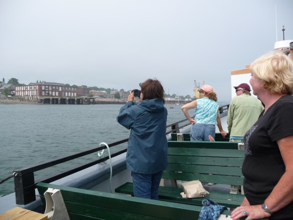 "Ferry passengers take photographs as the Quoddy Dam arrives in Eastport from Lubec. ""I was really excited to see there was a ferry,"" said Jeanne Smith-Cripps of New Hampshire, a visiting artist. ""What a fabulous idea."""