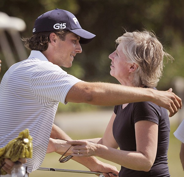 Bangor native Jessie Speirs gives his mom, Debi, a hug after winning the GBO in an extra 1-hole playoff round Saturday, July 23, 2011, at the Bangor Municipal Golf Course.