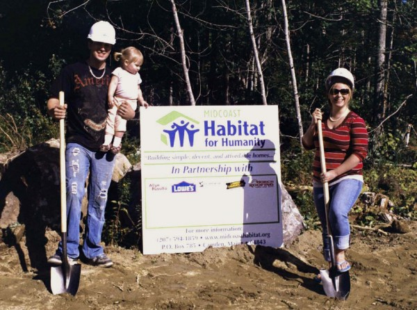 Dan and Amanda Shay and their daughter Aleah celebrate the moment at the groundbreaking for their new home in Thomaston, built by Midcoast Habitat for Humanity, last September. The house dedication was held July 10.