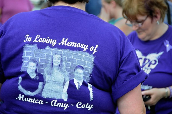 Friends and family of Amy Lake and her two children, Monica and Coty, wore purple T-shirts in their memory as well as to show their stand against domestic violence. The group of 100 or so signed the petition to name two bridges in Harmony after Lake and her children.