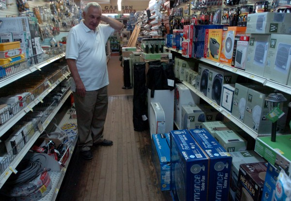 Sheldon Hartstone, owner of Fairmount Hardware in Bangor, surveys the store's dwindling inventory of fans on Thursday, July 21, 2011. The store has sold out of air conditioners.