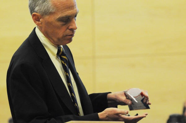 Penobscot County District Attorney Christoper Almy examines pieces of evidence, namely plastic grill parts, that belong to the truck owned by Garrett Cheney of South Berwick during his opening statements to the jury on Tuesday, July 19, 2011, at the Penobscot Judicail Center in Bangor. Cheny is accused of driving his truck into University of Maine student Jordyn Bakley of Camden as she walked down a snow-covered street in Orono in January 2010 and then driving away.