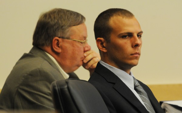 Garrett Cheney of South Berwick sits in a court room at the Penosbscot Judicial Center in Bangor and listens to opening statements to the jury on Tuesday, July 19, 2011. Cheny is accused of driving his truck into University of Maine student Jordyn Bakley of Camden as she walked down a snow-covered street in Orono in January 2010 and then driving away. With Cheney is one of his attorneys, Charles Taitt.