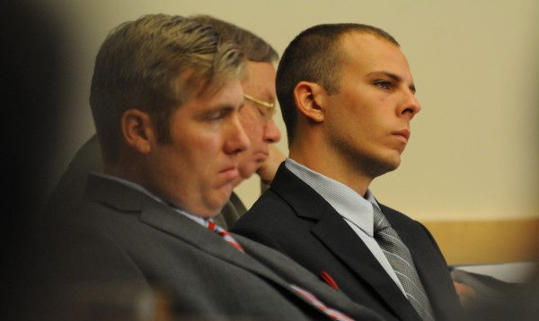 Garrett Cheney of South Berwick sits in a courtroom at the Penosbscot Judicial Center in Bangor and listens to opening statements to the jury on Tuesday, July 19, 2011.