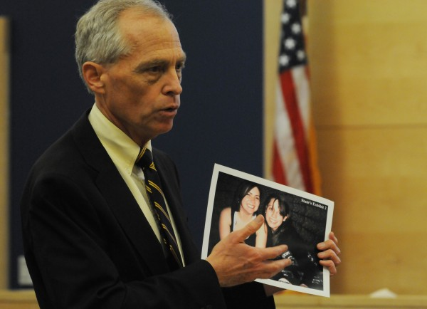 Penobscot County District attorney Christopher Almy offers closing arguments to the jury as he holds a picture of hit-and-run victim Jordyn Bakley (right in picture) at the Penobscot Judicial Center in Bangor on Thursday, July 28, 2011.