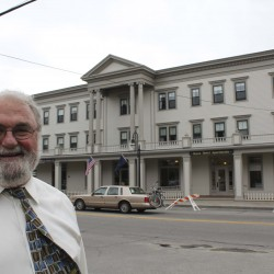 David Twombly stands in front of his building, the Knox Hotel in Main Street in Thomaston. The historic building was renovated in nine months with the help of state and federal tax credits.