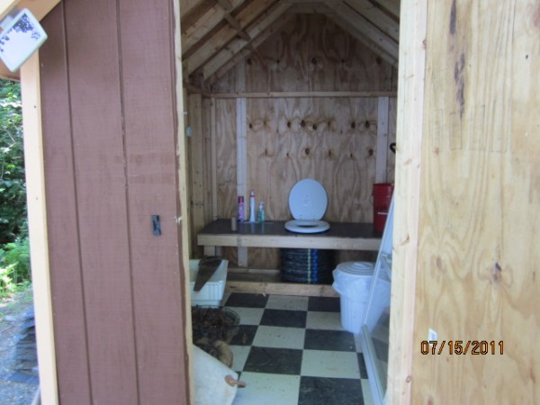 """Our little """"powder room"""" sits on 17 Round Pond Road in Charlotte, Maine. I built what I considered to be an outhouse, but my wife insisted that it would be referred as the """"powder room."""" My wife painted a """"For Rent"""" sign on it last summer and we actually had people want to rent it! This powder room replaced an old run-down privy. We are very proud of our outhouse and it serves us well when we are enjoying our camp on beautiful Round Pond in DownEast Maine!"""