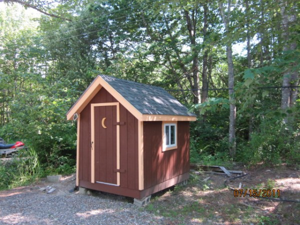 "Our little ""powder room"" sits on 17 Round Pond Road in Charlotte, Maine. I built what I considered to be an outhouse, but my wife insisted that it would be referred as the ""powder room."" My wife painted a ""For Rent"" sign on it last summer and we actually had people want to rent it! This powder room replaced an old run-down privy. We are very proud of our outhouse and it serves us well when we are enjoying our camp on beautiful Round Pond in DownEast Maine!"