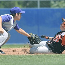 Hampden's Cam Scott (left) tags out Brewer's Evan Riva (11) at second on a steal attempt in the third inning of their Junior League all-star game at Mansfield Stadium in Bangor Saturday. Hampden won 23-1.