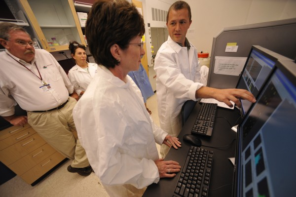 Adam Curtis (right), flow cytometer manager, explains the workings of the state-of-the-art device to Sen. Susan Collins during her tour of the Maine Institute for Human Genetics and Health in Bangor in August 2010. With them are (from left) Dr. Bruce Davis, hematopathiologist and president of Trillium Diagnostics, and Kathleen Davis, a clinical laboratory scientist with Trillium.