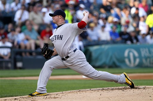 Boston Red Sox starting pitcher Jon Lester delievers to the Chicago White Sox in the first inning of a baseball game on Saturday, July 30, in Chicago.