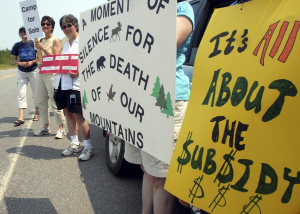Protesters stand on Route 6 outside First Wind's $130 million industrial wind site on Wednesday, July 20, 2011, saying the project was a blight on Rollins Mountain and would lead to declining land values in the project's four towns.