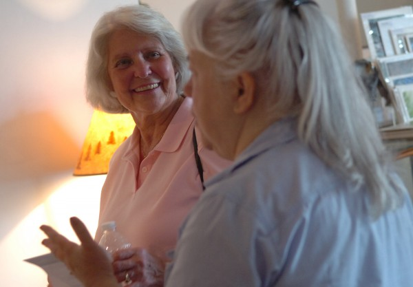 Judy Burke (left) mayor of Grand Lake, Colo., talks with Marsha Donahue (right) owner of the North Light Gallery, at the downtown Millinocket gallery on Monday, July 18, 2011. Burke was in Millinocket to share her experience as mayor of a gateway town to the Rocky Mountain National Park. Burke and Bill Pinkham, mayor of the Colorado town of Estes Park, were scheduled to attend a public meeting at Stearns High School on Monday evening concerning the creation of a Maine Woods National Park.