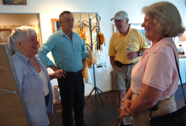 Marsha Donahue (from left) owner of the North Light Gallery in Millinocket, along with her husband, Wayne Curlew; Bill Pinkham, mayor of Estes Park, Colo.; and Judy Burke, mayor of Grand Lake, Colo.; discuss the potential of a Maine Woods National Park on Monday, July 18, 2011, in the gallery. Pinkham and Burke were visiting Millinocket to share their experiences related to the impact of a national park on nearby communities. Both Estes Park and Grand Lake are gateway communities to the Rocky Mountain National Park.