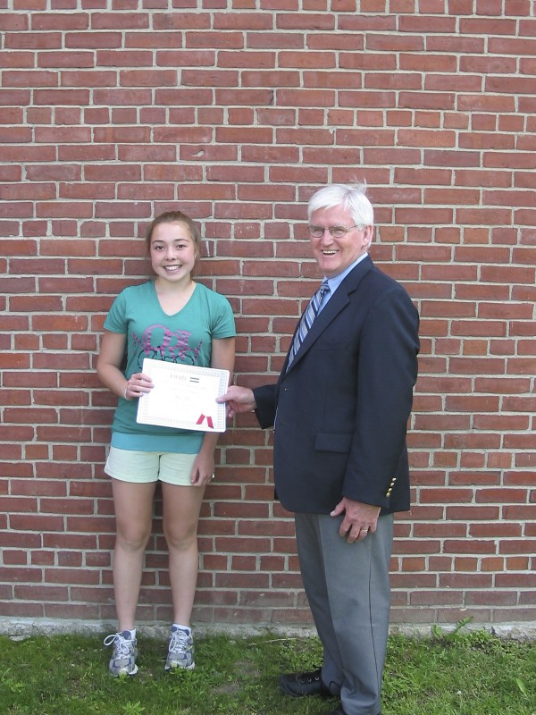 "Anna Ellis (left), a student at Orono Middle School, received the Lawrence Alan Spiegel Outstanding Student of the Year Award on June 20 from Scott Dow, president of the board at the Holocaust and Human Rights Center of Maine in Augusta. The Spiegel Award recognizes students at three grade levels who have produced an exceptional piece of original writing, fiction or non-fiction, or an unusually expressive work of visual or performance art relating to human rights. The award was presented to Anna in recognition of the poem she wrote, ""There's Always Hope: A Jewish Girl's Journey through a Concentration Camp."" Her poem was submitted by Debra Bishop, seventh-grade language arts and social studies teacher at OMS."