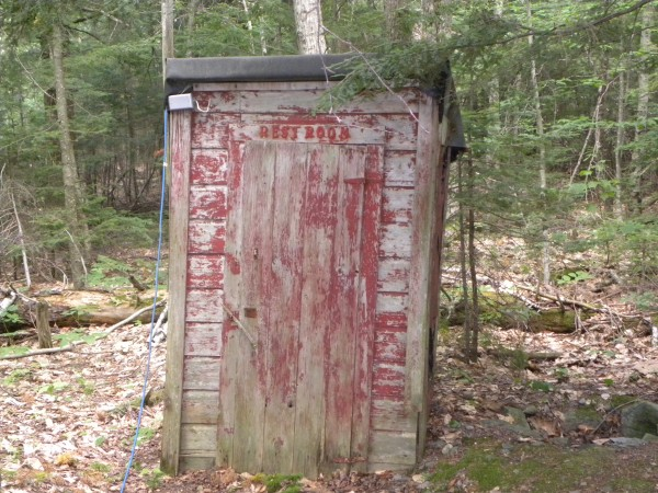"""What makes this outhouse outstanding is that it is still standing. What makes it special are the memories we have surrounding the outhouse. Being locked in it, being intruded on and having someone film the surprised look on your face to provide hours of family entertainment. Daring each other to go in it at night without the light on. Having a """"How long can you last"""" contest to see how long we could stay in it. We leave it up as a memorial to days gone by. Who knows maybe someone will dare to go it it again."""