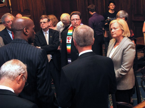 Rep. Chellie Pingree, D-Maine, meets with religious and civic leaders from around the country before they were arrested in the U.S. Capitol on Thursday, July 28, 2011, in an act of civil disobedience to protest cuts contained in the Boehner debt ceiling bill before the House. The leaders met with Pingree and she escorted them to the Capitol Rotunda, where they were arrested while praying.