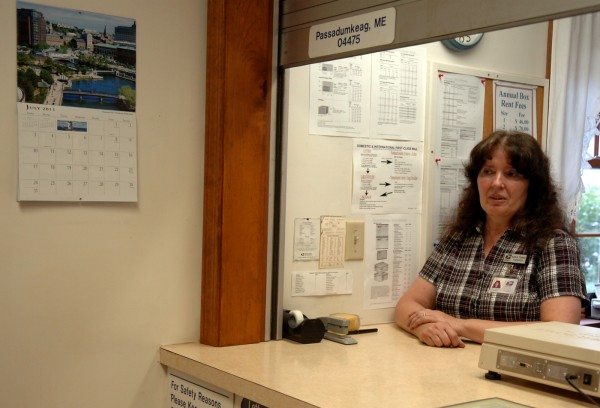 Karla Tower, postmaster of the Passadumkeag Post Office, behind the counter on Tuesday, July 26, 2011. On Tuesday, the U.S. Postal Service announced the closure of about 3,700 branches across the county, many of them in rural area. The list of branches scheduled for closure include 34 in Maine. Tower has worked in the Passadumkeag branch for 13 years.