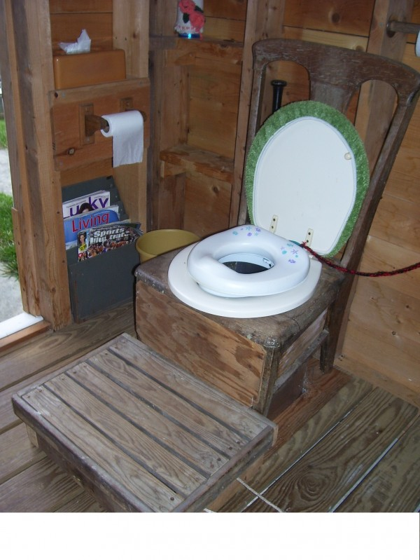 Our outhouse at Cedar Lake is complete with an antique 'throne'. And, it has a 'potty chair' insert for the grandchildren. We took an antique chair, removed the leather insert, and replace it with a toilet seat. When the grandchildren came to visit, we inserted the 'potty seat' and pushed up the sturdy step Grampy made for them to get to it. 