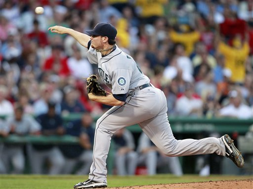 Seattle Mariners' Blake Beavan pitches in the second inning of a baseball game against the Boston Red Sox in Boston, Saturday, July 23, 2011.