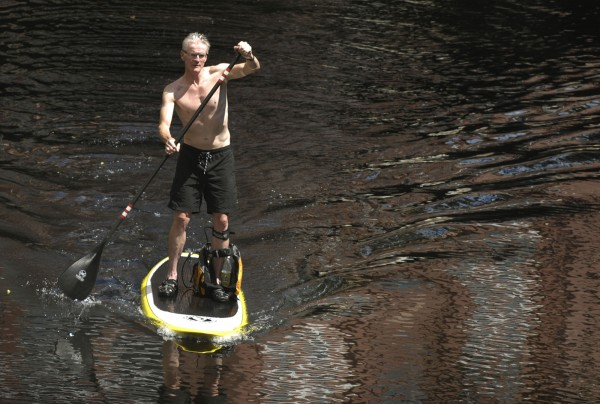 Martin O'Connell of Bangor enjoyed the great paddling weather going up and down the Penobscot River at the Bangor Waterfront and up the Kenduskeag Stream Saturday, July 16, 2011.