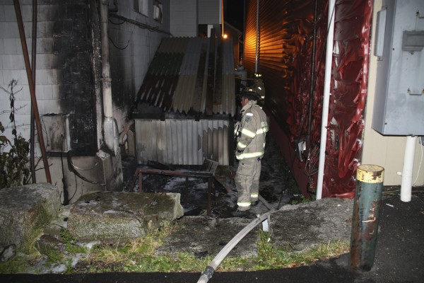 Assistant chief Adam Miceli inspects the damage to the Trade Winds Motor Inn in Rockland after the Rockland Fire Department was called to a structure fire at 12:43 a.m. Sunday, July 24, 2011.