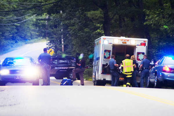 Rescue personnel load an injured person into an ambulance after a shooting at 322 Bennett Road in New Gloucester just before 7:30 p.m. Monday. A second person was also shot, police said.
