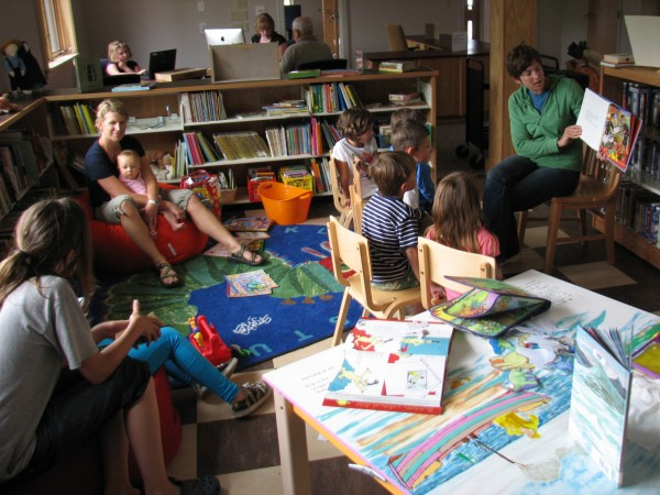 "Elizabeth Brennell reads ""Walter the Farting Dog"" to a group of children Saturday, July 9, 2011, at the new Swan's Island Library. The building opened up this week, three years after the former building burned to the ground from a lightning strike."