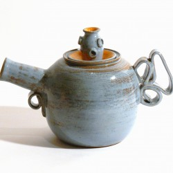 """Jemma Gascoine's teapot is one of the many on display at Lake Hebron Artisans in Monson for their second ceramic teapot show """"Teapots II"""" running through July 31."""