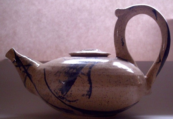 "Natalie Gardner's teapot is one of the many on display at Lake Hebron Artisans in Monson for their second ceramic teapot show ""Teapots II"" running through July 31."
