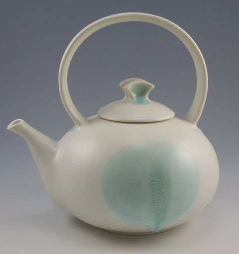"Simon van der Ven's porcelain teapot  is one of the many on display at Lake Hebron Artisans in Monson for their second ceramic teapot show ""Teapots II"" running through July 31."