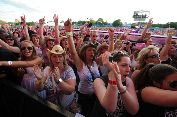 Fans react to Eric Church as he opens the show for Toby Keith on the Bangor Waterfront on Saturday, July 9, 2011.